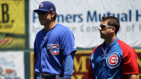 Anthony Rizzo walks off the field on Tuesday with a Cubs trainer.