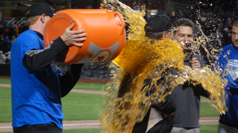 Nathan Adcock douses manager Mike Jirschele with Gatorade.